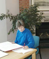 Worker using Simcoe County Branch library collection